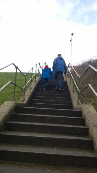 Dad and son make the climb