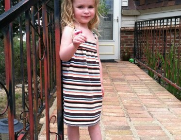Tiny-Small wearing a striped dress.