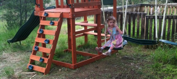 A swing set makes a three year old happy