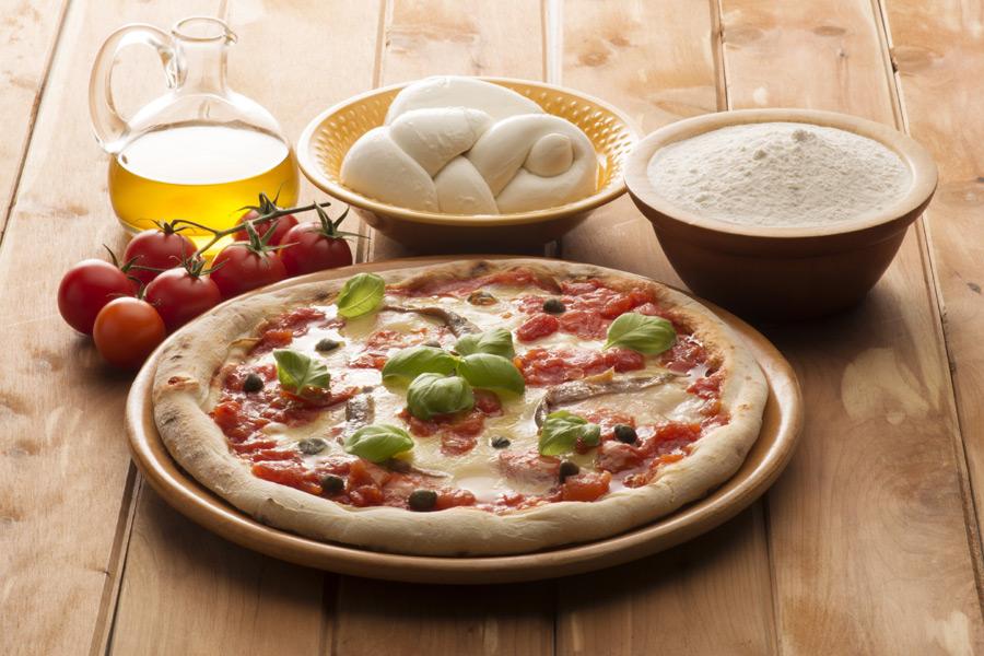 pizza with basil and mozzarella wine