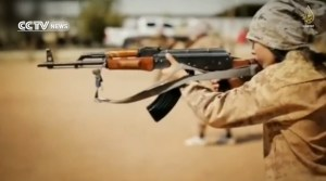 The same boy shooting a Kalashnikov