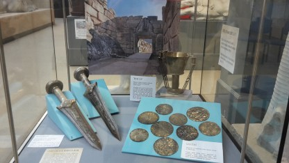 Replicas of daggers, a cup, and gold disks