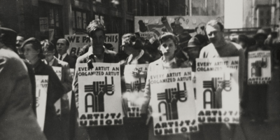 "Union members rally for awareness. From left to right: Edward ""Deyo"" Jacobs, Winifred Milius, and Hugh Miller. Photograph by Irving Marantz."