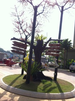 Cute direction sign making full use of a tree :D