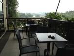 Relaxing setup at the verandah wit greens panorama.