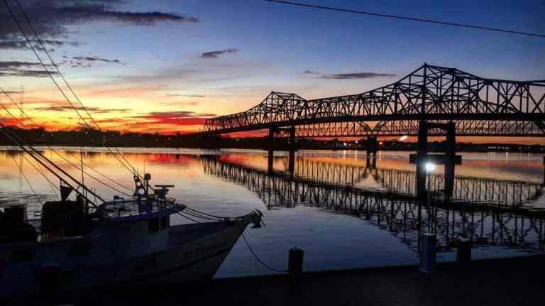 Louisiana Bridges on the Atchafalaya River at dusk with shrimp boat