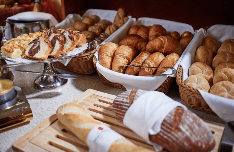 hotel austria vienna inner stadt boutique hotels interior breakfast croissant french pastry bread