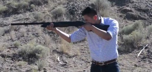 Estakio Beltran firing shotgun in campaign ad.