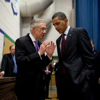 President Barack Obama talks with Senate Majority Leader Harry Reid (D-Nev.)
