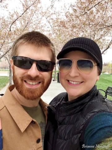 Brianne Nemiroff and Benjamin Hagerty in front of cherry blossoms at the Utah State Capitol Building in Salt Lake City