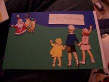 Kids waving to Santa on a Christmas card