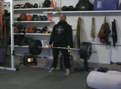 A person exercising in garage gym