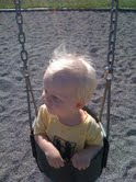 E on the swing at the park 2