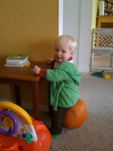 e sitting on a pumpkin