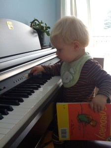 e playing piano with a book