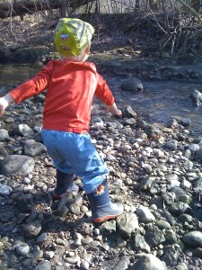 E throwing rocks in the river