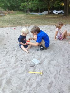 E and J playing in the sand
