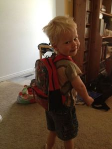 three-year-old with spiderman backpack