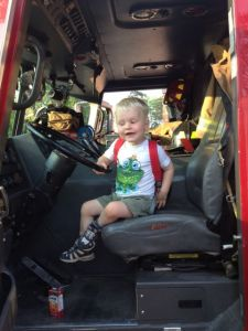 three-year-old in a fire truck