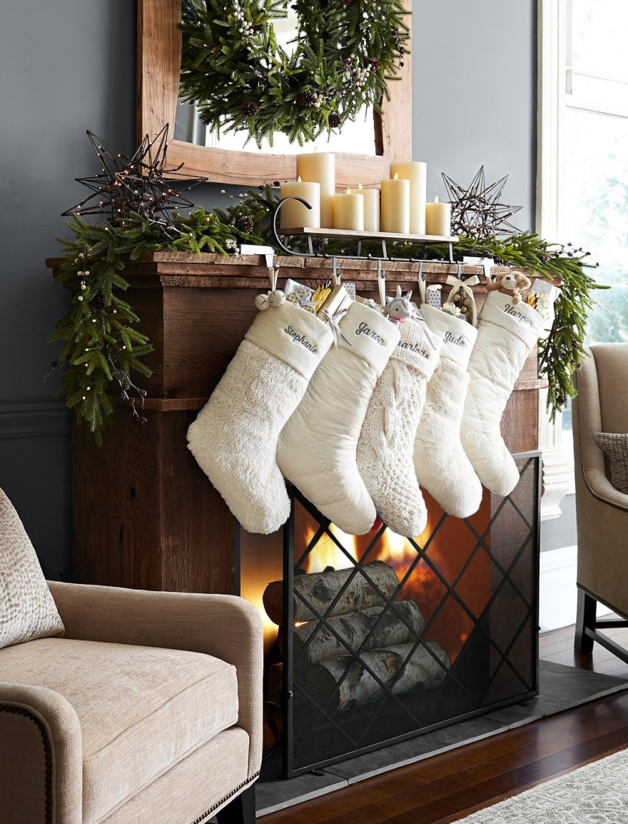chunky knit, shiny velvet, faux fur hanging at fireplace mantle