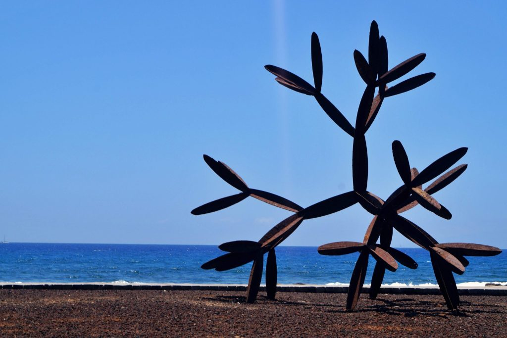 Art piece in Playa de las Americas in front of the sea