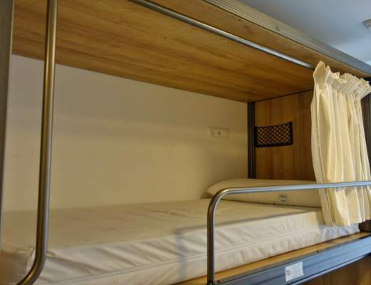 Hostel bed with curtain