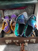 Shoes stored in vintage brown leather suitcase