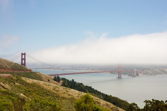 The Golden Gate Bridge through the fog seen from Hawk Hill