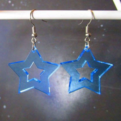 neon blue rave star cutout earrings