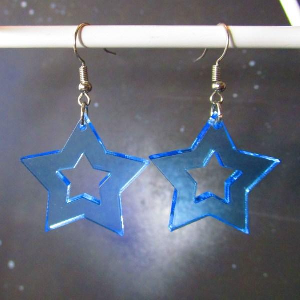 neon blue rave star cutout earrings