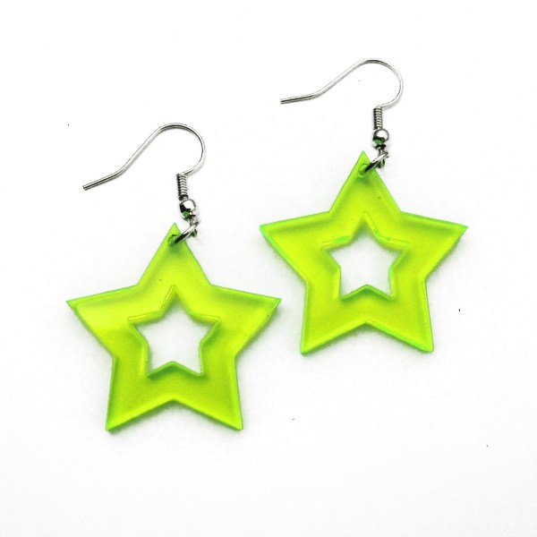 neon green star dangle earringson white background