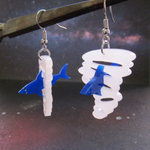 blue shark and white tornado sharknado earrings dangle off metal rod with space background