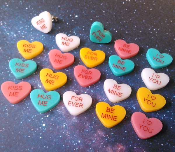collection of Customized Candy Hearts Stud Earrings laying on space background