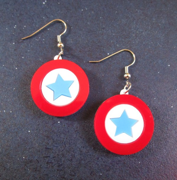 close up of Captain America Mini Shield Earrings on space background