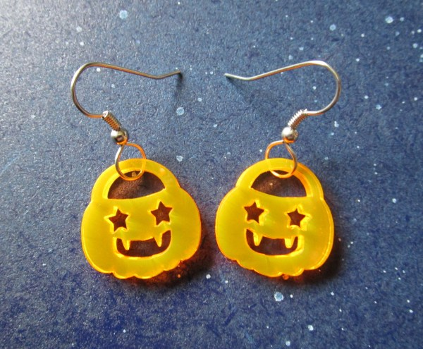 closeup of halloween pumpkin earrings