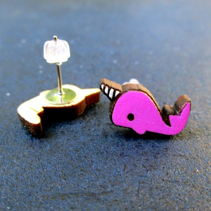 pink cute narwhal stud earrings one upside down to show post and the other facing front