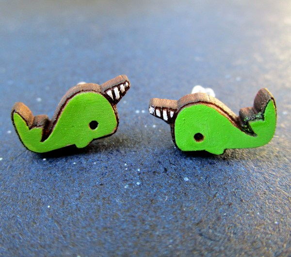 2 green narwhal stud earrings close up
