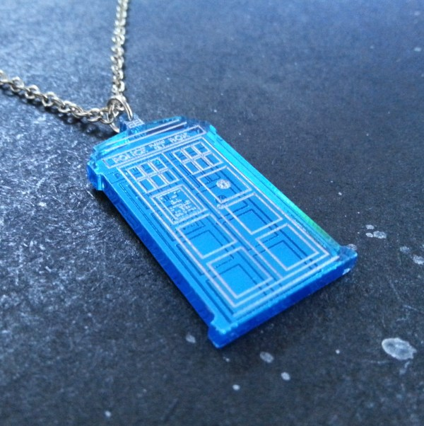 close up side view of Doctor Who Police box pendant necklace