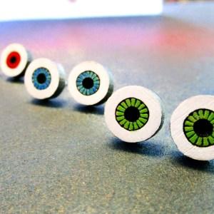 3 sets of wood eye pendant stud earrings, pairs of green, blue and red eye pendants