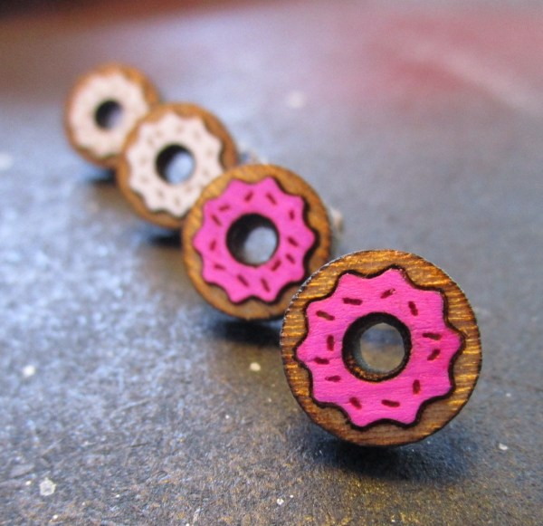 pair of pink donuts and white donut earrings