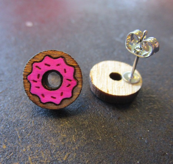 sprinkle donut shaped stud earrings with pink frosting