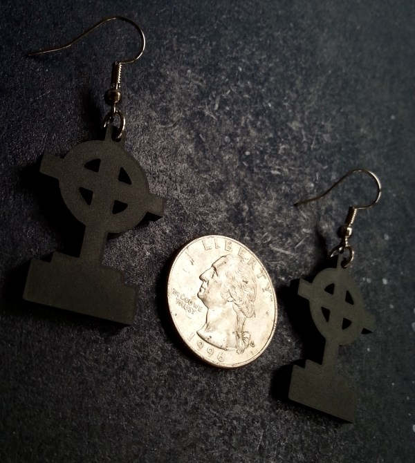 gravestone headstone halloween earrings next to US quarter for size reference