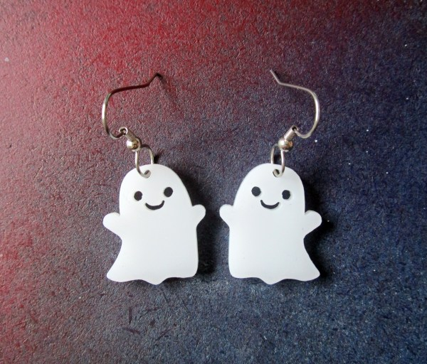 close up of front of cute smiling ghost earrings with french hook earrings