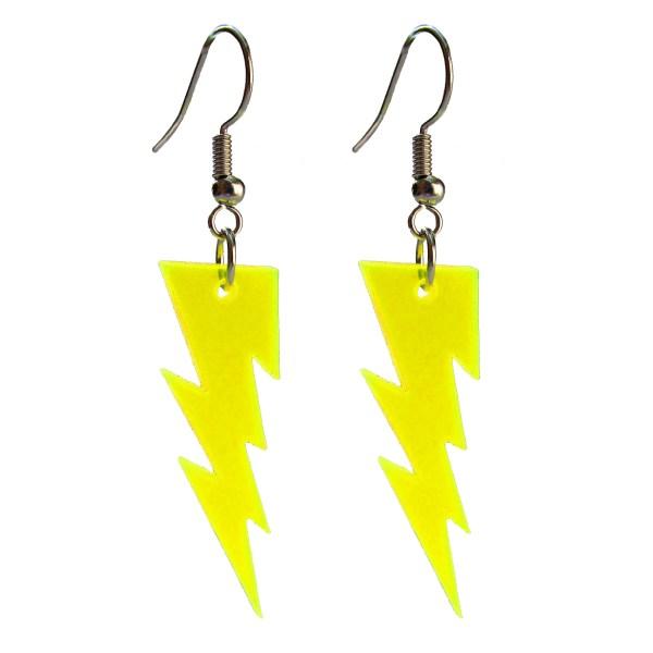yellow lightning bolt earrings floating on white background