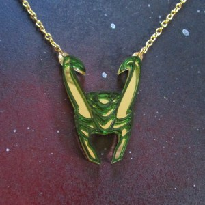 front view of God of Mischief Loki Helmet Necklace with gold chain on space background