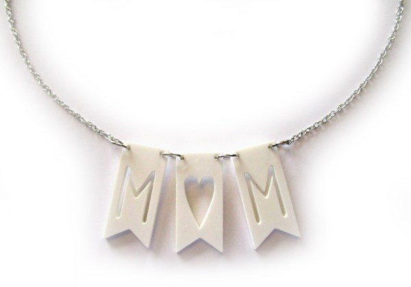 white bunting flag necklace with word mom cut out on white background