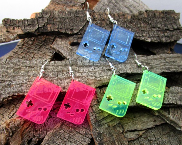 miniature handheld gameboy dangle earrings on wood background
