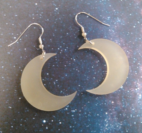 light yellow matte moon earrings on space background