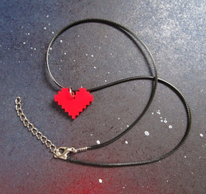 pixel heart necklace with black cord chain on space background