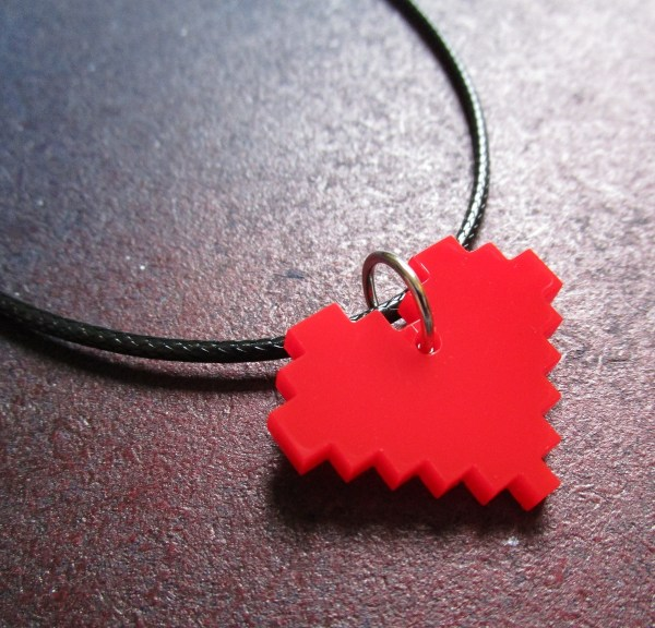 Close up of red 8 bit pixel pendant necklace